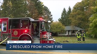 North Royalton firefighters rescue 2 people, dog from house fire