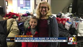 Brother and sister collect nearly 400 pairs  of socks for homeless - Video