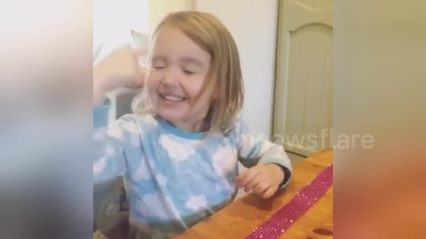 Pre-schooler pokes her face trying to 'touch her dreams'