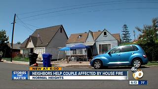 Neighbors help couple affected by house fire - Video