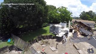 Drone video shows damage from Pasco County sinkhole - Video