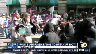 Police use flash bangs to break up riot - Video