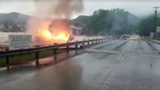 Dramatic Video Shows Floods Sweep Away Burning House - Video
