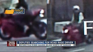 Search for motorcyclist who threw rock at truck - Video