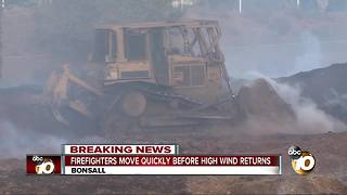 Firefighters move quickly before high wind returns - Video