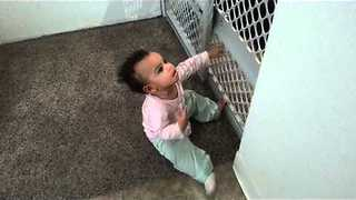 11-Month-Old Girl Climbs On Baby Gate With Ease - Video