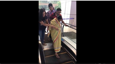 Woman terrified of escalator, takes stairs instead