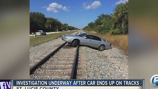 Investigation underway after car ends up on tracks - Video