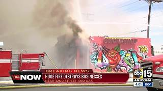 Firefighter treated for heat exhaustion after battling blaze that destroyed businesses