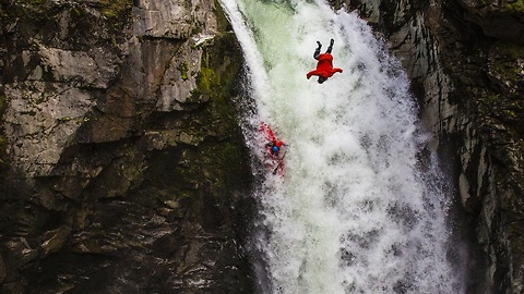Kayaker And Daredevil Take Part In Simultaneous Waterfall Jump
