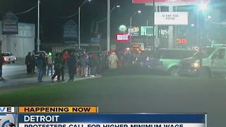 Workers protest outside McDonald's in Detroit to fight for higher minimum wage