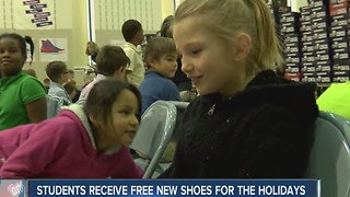 Students receive new shoes for holidays - Video