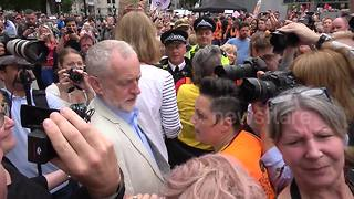 Jeremy Corbyn jostled by fans, media and protester as he arrives at Tories Out demo - Video
