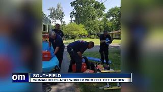 Woman helps AT&T worker who fell off ladder - Video