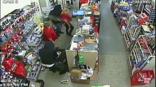 Authorities are looking for two men who robbed a Family Dollar at gunpoint - Video