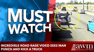 Incredible road rage video sees man punch and kick a truck - Video