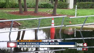 Submerged sidewalk leaves residents simmering - Video
