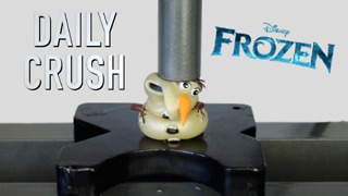 Olaf toy gets crushed by hydraulic press - Video