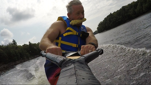 Hungry wake boarder takes unusual snack along for ride