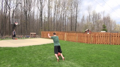 Frontflip basketball trick shot from 40 feet away