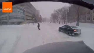 Snowboarder Towed Through Canadian Street - Video
