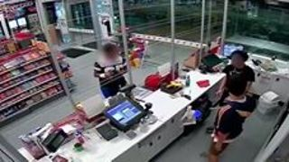 CCTV Vision Shows Man Climb Over Counter and Threaten Employee - Video