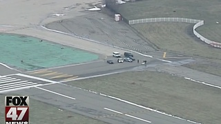 Body found on Detroit airport runway - Video