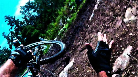 Mountain biker performs flawless tuck-and-roll wipe out