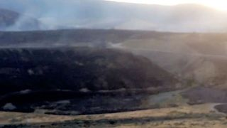 Wildfire Smoke Streams From Mountains Surrounding Ashcroft - Video