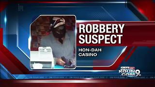 Authorities searching for armed casino robber - Video