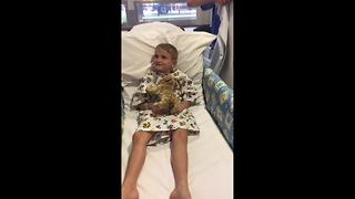Clown doctors serenade boy before he receives heart surgery - Video