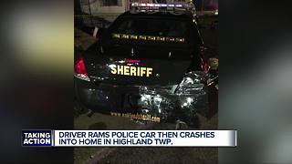 Driver rams police car then crashes into home in Highland Township - Video