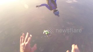 Skydiver in flying mid-air headbutt at 12,000ft - Video