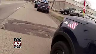 Video shows gunfire exchange with Lansing police - Video