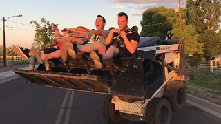 Crazy thrill ride in bucket of Bobcat loader - Video