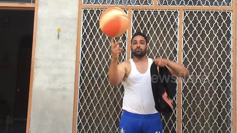 Ace basketballer changes T-shirt while spinning ball on his finger