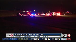 Driver injured after truck overturns into pond at I-75 on-ramp