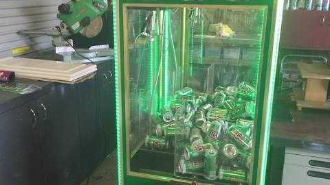 Man turns claw machine into beer can skill tester