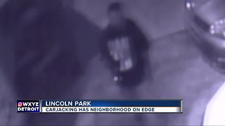 Carjacking at gunpoint caught on video