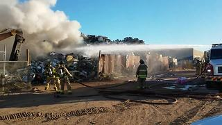 Crews puts out metal recycling plant blaze - Video