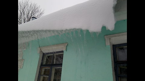 Snow and ice sliding down from the roof