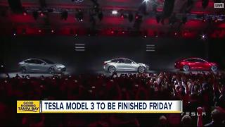 Tesla says its Model 3 car will go on sale on Friday - Video