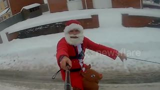 Hilarious moment Santa spread cheer throughout village - on SKIS - Video