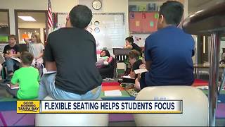 Local schools replace school chairs with bouncy balls to help kids focus - Video