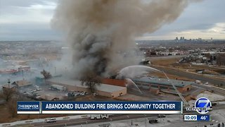 Abandoned building fire brings community together.