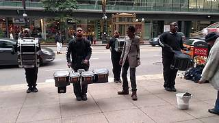 Amazing drumline gets help from surprise backup dancers  - Video