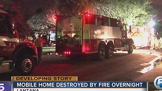 Two hurt in mobile home fire - Video