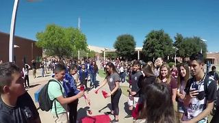 Student's flashy homecoming proposal - Video