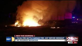 Tulsa Firefighters battle garage fire before midnight - Video
