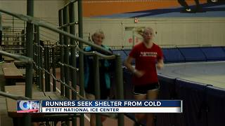 Area runners seek shelter from cold conditions - Video